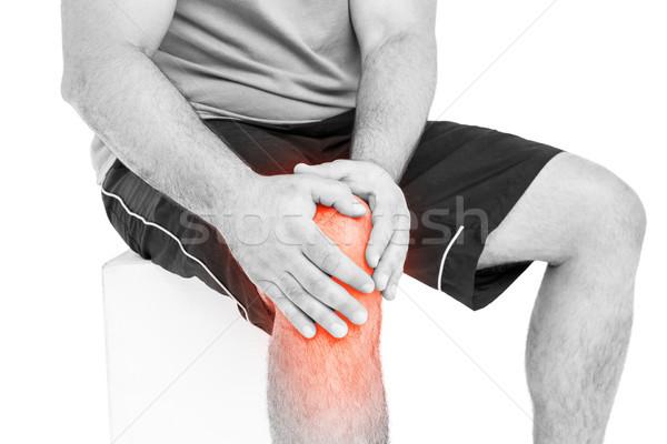 Középső rész férfi szenvedés térd fájdalom fehér Stock fotó © wavebreak_media