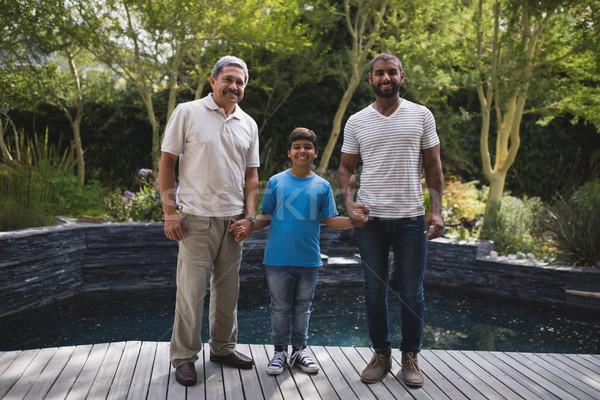 Portrait of smiling multi-generation family holding hands at porch Stock photo © wavebreak_media