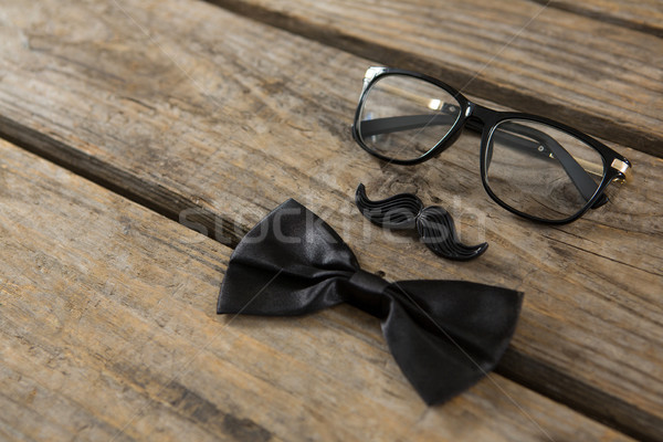 High angle view of bow tie with mustache and eyeglasses on table Stock photo © wavebreak_media