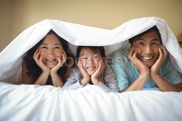 Család megnyugtató együtt pléd hálószoba otthon Stock fotó © wavebreak_media