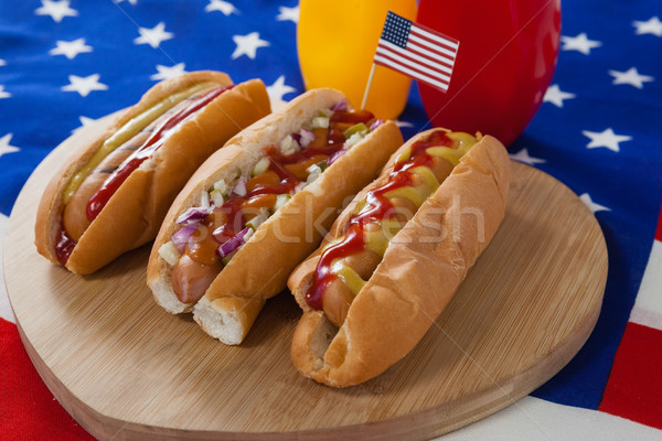 Hot dog and American flag on white wooden table Stock photo © wavebreak_media