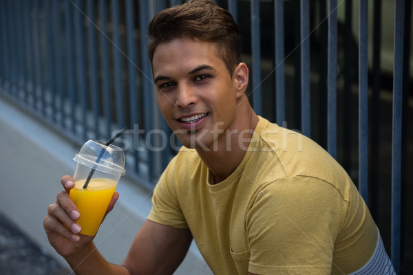 Portrait of smiling man holding juice Stock photo © wavebreak_media