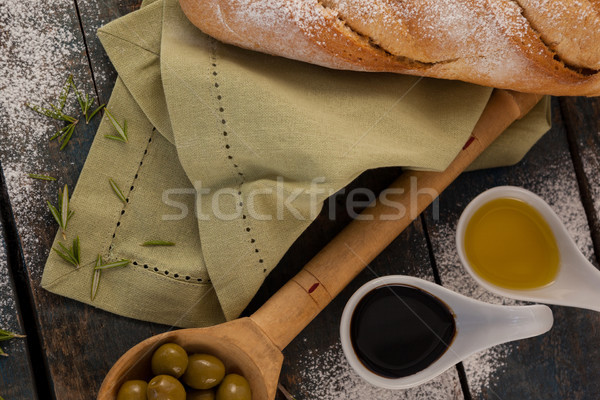 Overhead view of olive oil by bread on table Stock photo © wavebreak_media