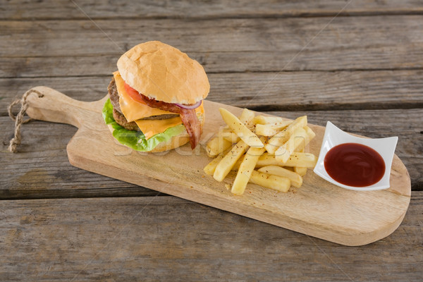 High angle view on burger with French fries and sauce Stock photo © wavebreak_media