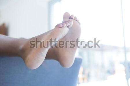 Baixo seção menino sessão descalço sofá Foto stock © wavebreak_media