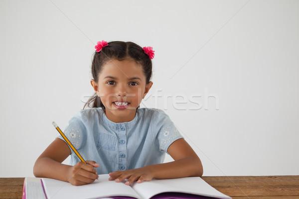 Дать книга белый портрет ребенка Сток-фото © wavebreak_media