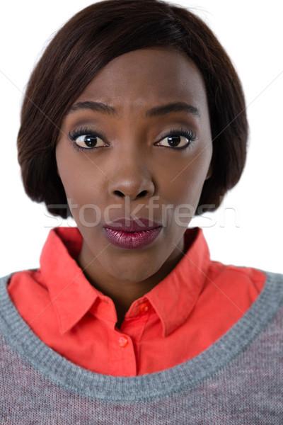 Portrait of young woman puckering Stock photo © wavebreak_media
