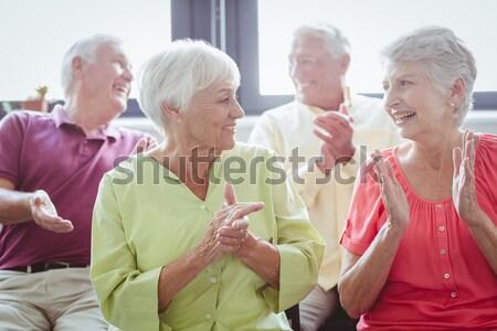 Happy senior people doing stretching exercises at park Stock photo © wavebreak_media