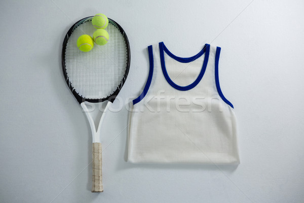 Overhead view of racket with tennis balls by vest Stock photo © wavebreak_media