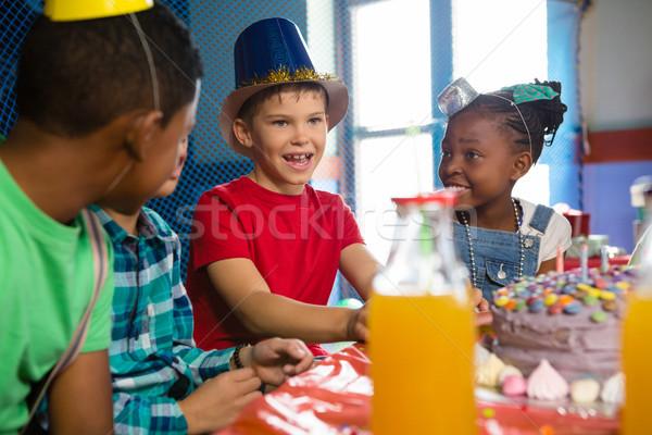 Children talking while sitting at table Stock photo © wavebreak_media