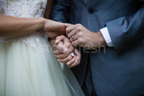 Wedding couple holding hands Stock photo © wavebreak_media