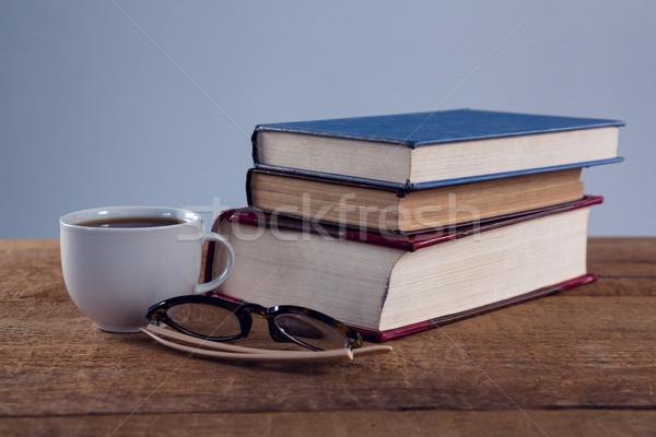 クローズアップ 眼鏡 ブラックコーヒー 図書 スタック 木製のテーブル ストックフォト © wavebreak_media