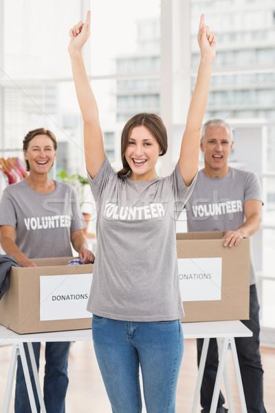 Juichen vrouwelijke vrijwilliger collega's portret kantoor Stockfoto © wavebreak_media