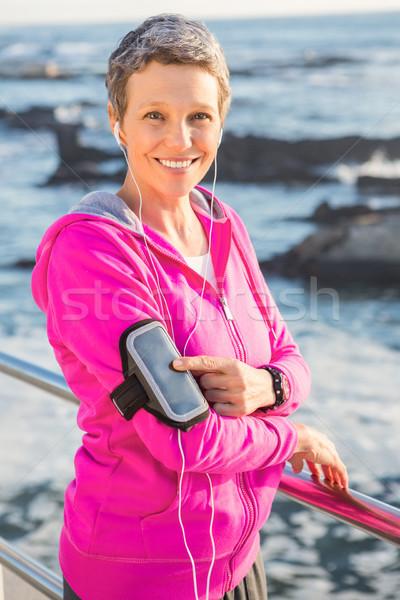 улыбаясь женщину музыку наушники Сток-фото © wavebreak_media