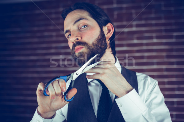 Portrait of man holding cutting beard with scissors Stock photo © wavebreak_media