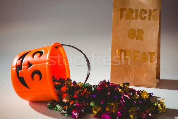 Sztuczka tekst torby papierowe wiadro kolorowy Zdjęcia stock © wavebreak_media