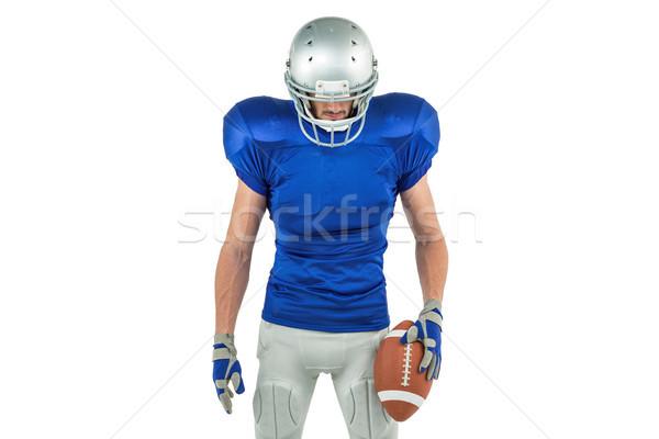 Amerikaanse voetballer naar beneden te kijken bal witte Stockfoto © wavebreak_media