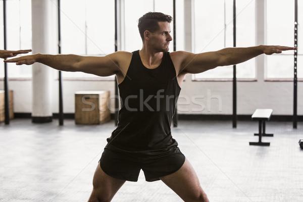 Fókuszált férfi nyújtás kar tornaterem test Stock fotó © wavebreak_media
