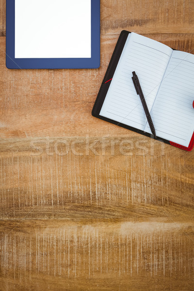 Stock photo: Business desk with tablet and notebook