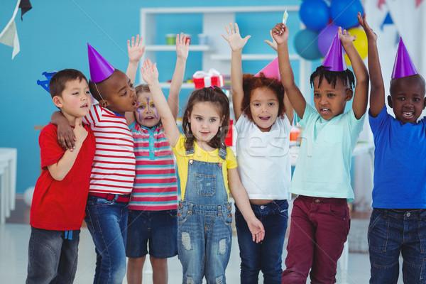 Happy kids enjoying a birthday party Stock photo © wavebreak_media