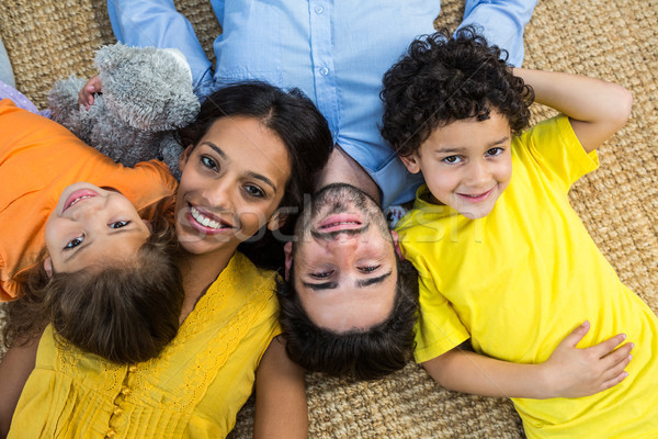 Smiling family laying on carpet Stock photo © wavebreak_media