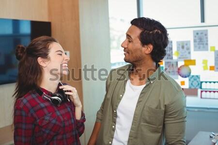 Female athlete talking to male trainer at health club Stock photo © wavebreak_media