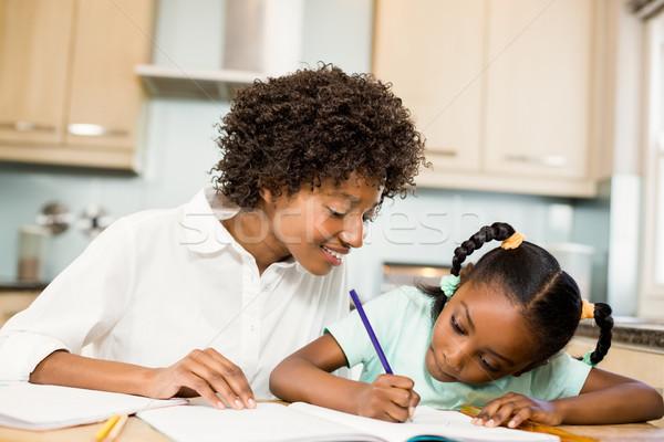 母親 宿題 キッチン 女性 幸せ 子 ストックフォト © wavebreak_media