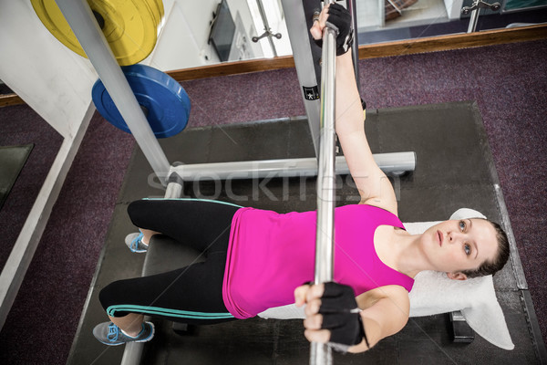 Fit woman lifting the barbell bench press Stock photo © wavebreak_media