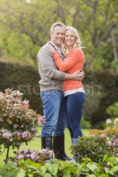 Portrait of cute couple hugging Stock photo © wavebreak_media