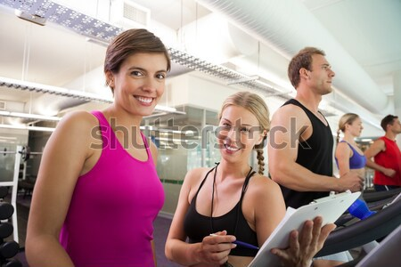 Athletic smiling women posing with bottle of water Stock photo © wavebreak_media