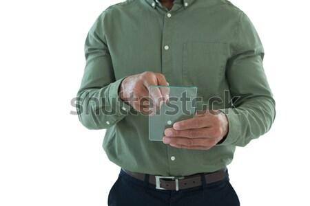 Male executive using glass digital tablet Stock photo © wavebreak_media