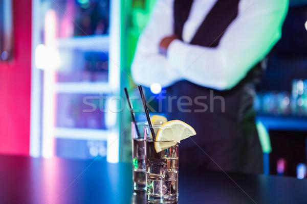 Due occhiali gin bar counter barista Foto d'archivio © wavebreak_media