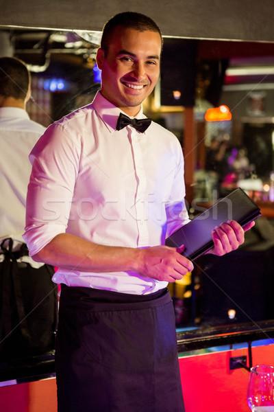 Portret kelner stałego menu karty bar Zdjęcia stock © wavebreak_media