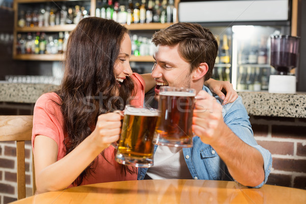 Couple toasting with beers Stock photo © wavebreak_media