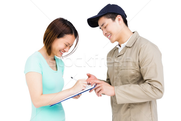 Delivery man taking signature of woman Stock photo © wavebreak_media