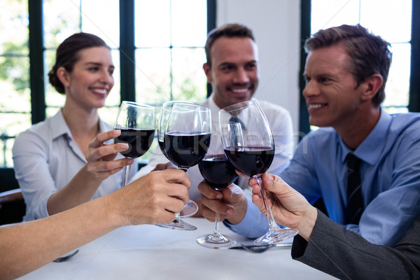 Group of businesspeople toasting wine glass during business lunc Stock photo © wavebreak_media