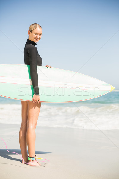 Retrato mujer tabla de surf playa Foto stock © wavebreak_media
