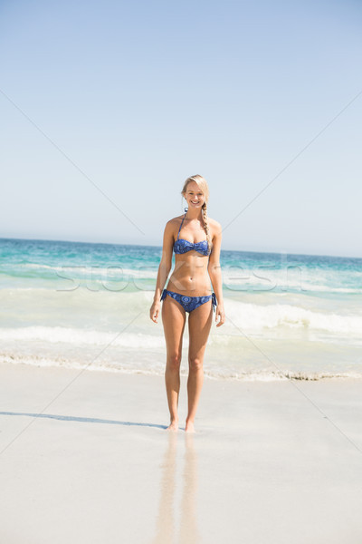 Szczęśliwy kobieta bikini stałego plaży Zdjęcia stock © wavebreak_media