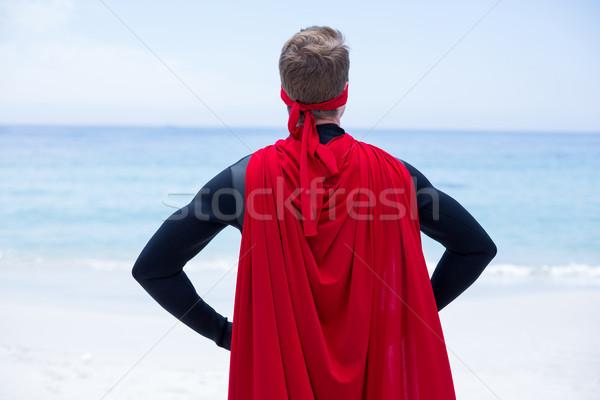 Superhero kostium strony biodro morza brzegu Zdjęcia stock © wavebreak_media