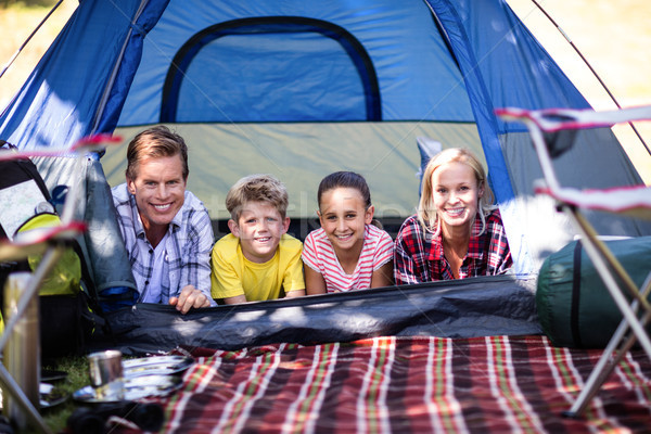 Happy family lying in a tent Stock photo © wavebreak_media