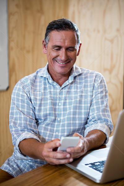 男 電話 座って デスク ノートパソコン ストックフォト © wavebreak_media