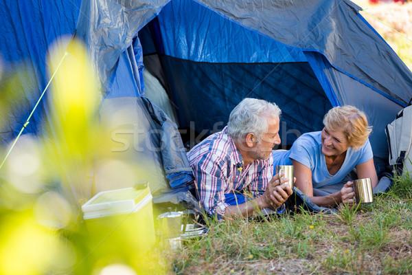 зрелый пару улыбаясь глядя другой лагерь Сток-фото © wavebreak_media
