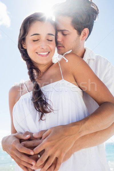 Happy couple embracing on the beach Stock photo © wavebreak_media