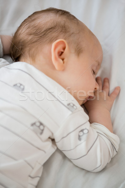 Baby boy sleeping on bed Stock photo © wavebreak_media