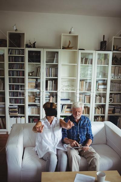Senior couple using digital tablet and virtual reality headset Stock photo © wavebreak_media