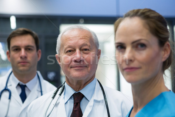 Smiling doctors and surgeon standing together in hospital Stock photo © wavebreak_media