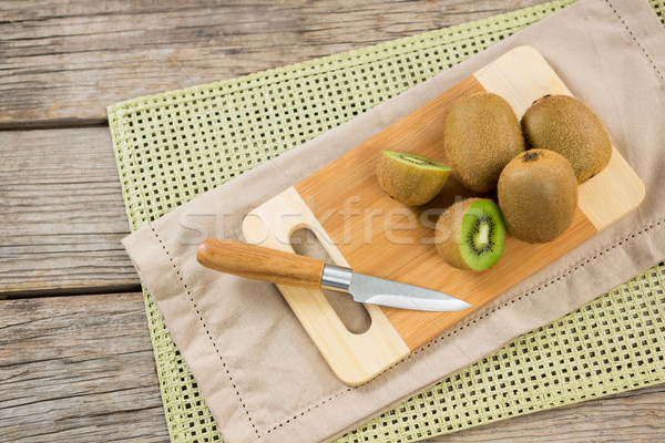 Kiwis with knife on chopping board Stock photo © wavebreak_media