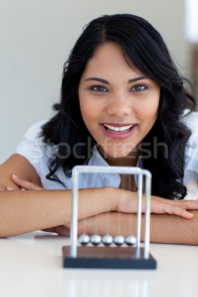 Businesswoman playing with Newton balls Stock photo © wavebreak_media