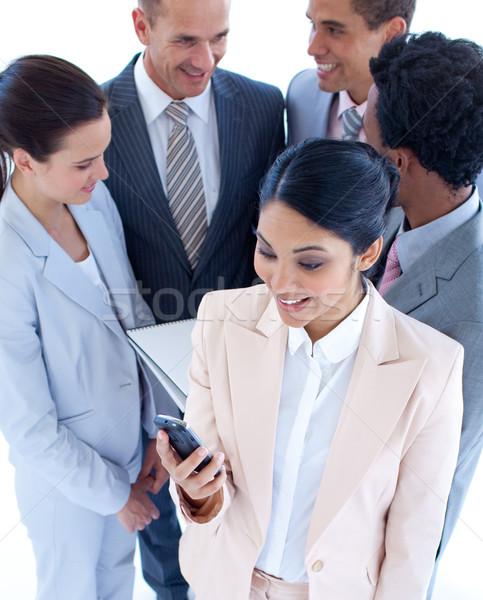女性実業家 送信 文字 チーム 携帯電話 ストックフォト © wavebreak_media