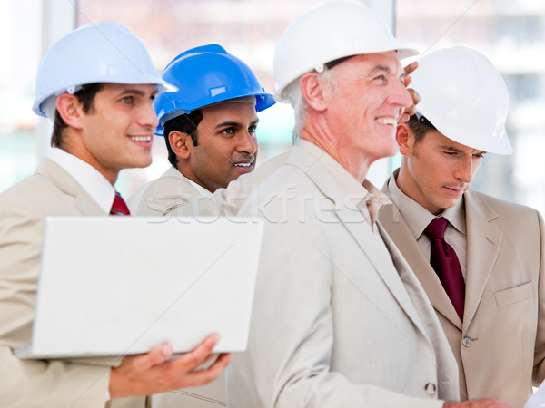 Condifent architect team working on a building project Stock photo © wavebreak_media